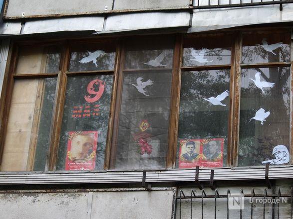 Пустые улицы и «Бессмертный полк» на балконах - фото 71